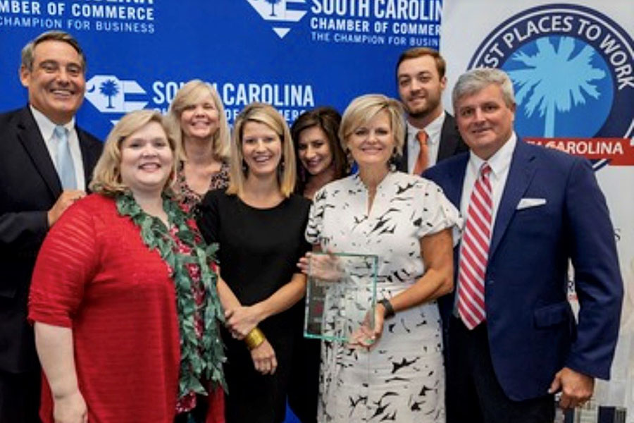Refer A Friend - Turner Agency Staff Accepting Best Places To Work Award